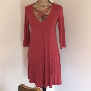 Socialite dress size small criss cross at chest.